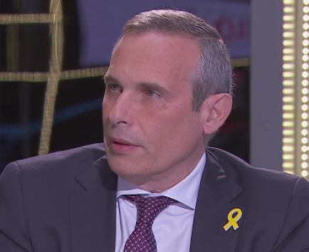 Torra fitxa un dels acompanyants de Puigdemont